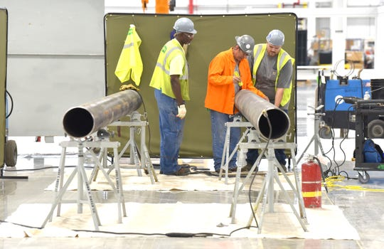 Employees work in the new body shop at the FCA Mack Avenue Site.