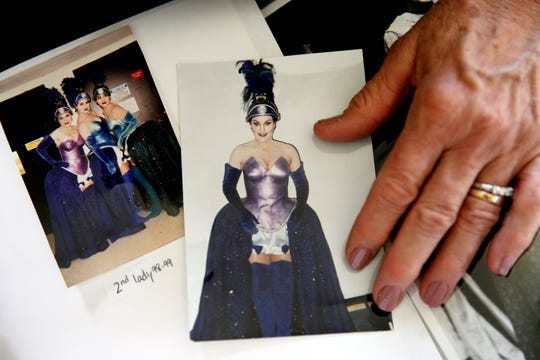 "Retired opera singer Patricia Wulf shows photos of herself at right and also at far left in the photo at left, in costume for her role in ""The Magic Flute"" in 1998 at the Washington Opera."