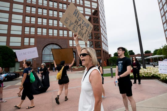 "Protestors march and chant outside a Prudential financial services branch office building on West Big Beaver, in Troy, August 13, 2019. The protestors claim that Prudential is a large investor of the GEO Group, a Florida-based private prison operator, which plans to re-open a correctional facility in Baldwin to house ""non-U.S. citizen criminals""."