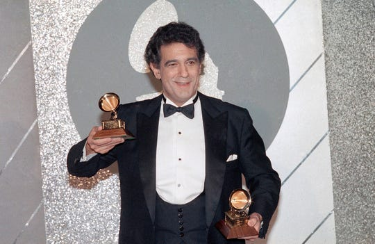 Placido Domingo holds his two trophies during the Grammy Awards ceremonies in 1985.