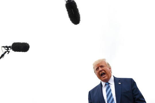 President Donald Trump talks to the media before boarding Air Force One at Morristown Municipal Airport in Morristown, N.J., Tuesday, Aug. 16, 2019.