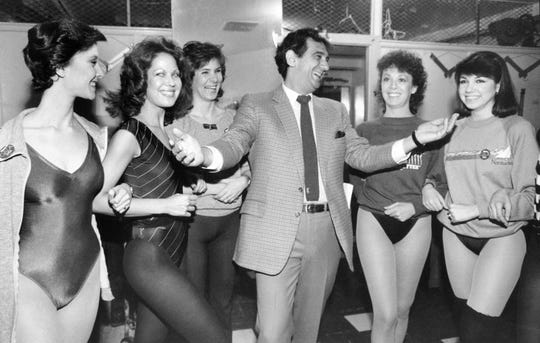 "Placido Domingo laughs with members of the Rockettes at New York's Radio City Music Hall on Feb. 27, 1984. The singer and dancers met while rehearsing for Channel Thirteen's ""Gala of Stars 1984."""