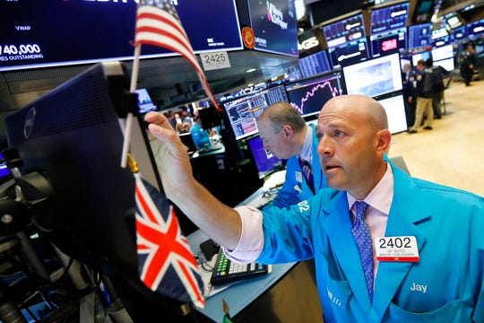Specialist Jay Woods works at his post on the floor of the New York Stock Exchange, Tuesday, Aug. 13, 2019. Stocks tore higher Tuesday, continuing their roller-coaster ways, after the latest turn in the U.S.-China trade war flipped investors back to buying mode.