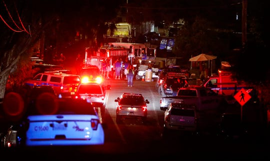 In this July 28, 2019 file photo, law enforcement works the scene of a shooting at the Gilroy Garlic Festival in Gilroy, Calif. The FBI has labeled two of those attacks, at a Texas Walmart and the California food festival, as domestic terrorism — acts meant to intimidate or coerce a civilian population and affect government policy. But the bureau hasn't gone that far with a shooting at an Ohio entertainment district..