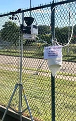 A device takes samples to measure air quality outside Poupard Elementary School in Harper Woods. Testing began Aug. 1 and will continue through the school year.