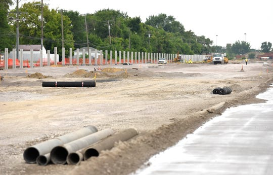A wall will be placed between the neighborhood and the employees parking lot that used to be St. Jean Street.