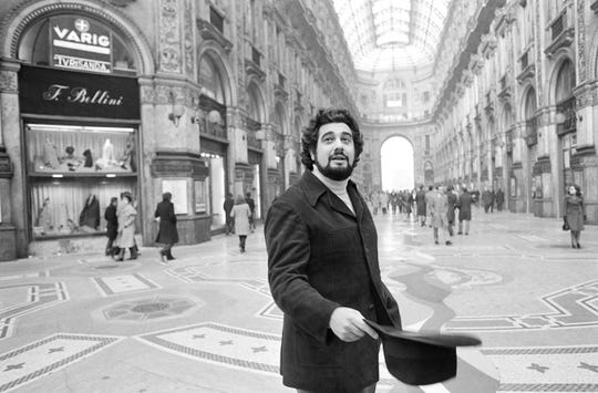 Placido Domingo, who inaugurated the season at La Scala, walks in the Piazza Scala with the Opera House in the background, in Milan on Dec. 12, 1972.