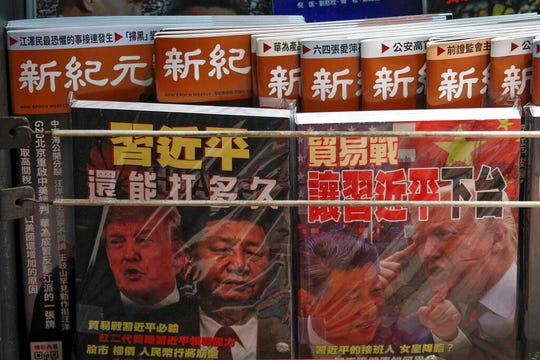 In this July 4, 2019, photo, Chinese magazines with front covers featuring Chinese President Xi Jinping and U.S. President Donald Trump on trade war is placed on sale at a roadside bookstand in Hong Kong. Facing another U.S. tariff hike, Xi is getting tougher with Washington instead of backing down. Both sides have incentives to settle a trade war that is battering exporters on either side of the Pacific and threatening to tip the global economy into recession.
