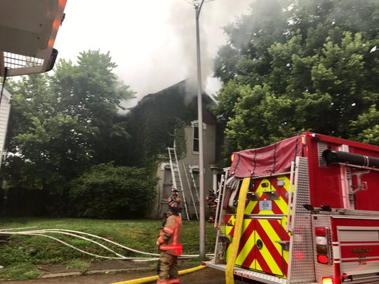 Firefighters at the scene of a house fire at 1919 W. Indiana St. on Aug. 13, 2019.