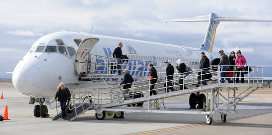 Passengers get off an Allegiant airplane at the Fort Collins-Loveland Municipal Airport in this Jan. 27, 2012, file photo.