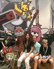 Cape Coral teen Regan Retzloff, far left, poses with his family in Nashville, where he competed at the 2018 Pokémon World Championships.