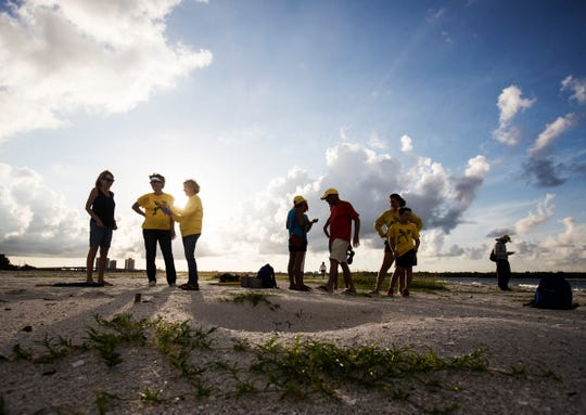 A number of Turtle Time Inc. volunteers were on hand to watch as the first documented green sea turtle nest was excavated on Sunday, August, 11, 2019 on Fort Myers Beach. Thirty-eight hatchlings made it to the Gulf of Mexico.