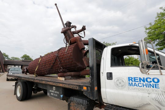 "The ""Logger"" statue loaded on a trailer Tuesday, August 13, 2019, at the former Bank Mutual location on North Monroe Avenue in Green Bay, Wis. The statue was given to the Neville Museum by Associated Bank and will be displayed outside."