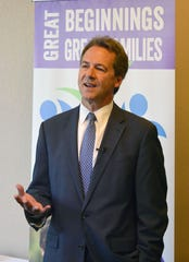 Gov. Steve Bullock talks Tuesday at the Great Beginnings, Great Families Conference in Helena.