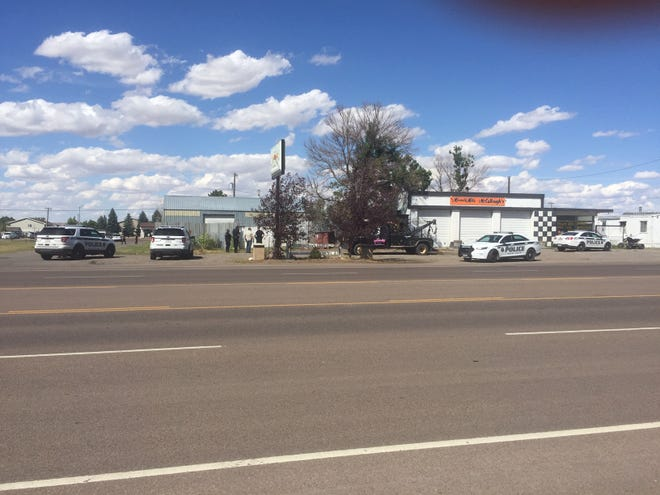 Law enforcement officers were searching the area around Malmstrom Air Force Base's entrance on 2nd Avenue North.