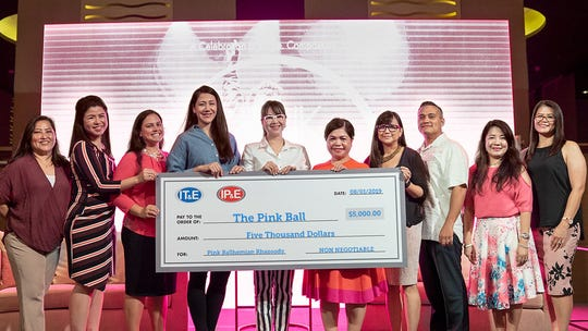 Earlier this month IT&E and its sister company, IP&E holdings, LLC, presented The Pink Ball committee with a donation of $5,000 in support of The Pink Ballhemian Rhapsody held Aug. 3 at the Dusit Thani Guam Resort. Proceeds from this annual charity event will benefit Guam Cancer Care and Harvest House. Pictured from left: Annette Garces, Pink Ball committee member; Trixie Naholowaa, Pink Ball committee member; Mariana Cook-Huynh, Pink Ball co-chairwoman; Camille Denight, marketing manager of IP&E Holdings, LLC; Rubyjane Buhain-Redila, brand and public relations manager of IT&E; Leah Beth Naholowaa, Pink Ball chairwoman; Charly Lauron, Pink Ball secretary; Charlie Hermosa, Pink Ball treasurer; Roma Velasco, Pink Ball committee member and Nona Perez, Pink Ball committee member.