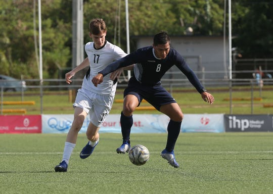 Mark Chargualaf of the Matao, Guam Men's National Team, attempts to keep back Guam U19 Men's National Training Squad's Caleb Elwell from the ball during a inter-squad scrimmage at this year's Kåmp Tinituhon at the Guam Football Association National Training Center. The GFA Technical Department plans to expand the induction camp's offerings following the success of its inaugural edition.