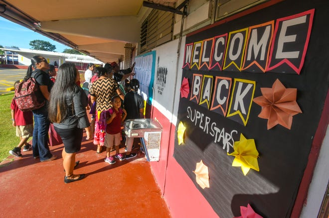 Parents and students arrive at Captain H. B. Price Elementary School in Mangilao to begin the first day of school on Tuesday, Aug. 13, 2019.