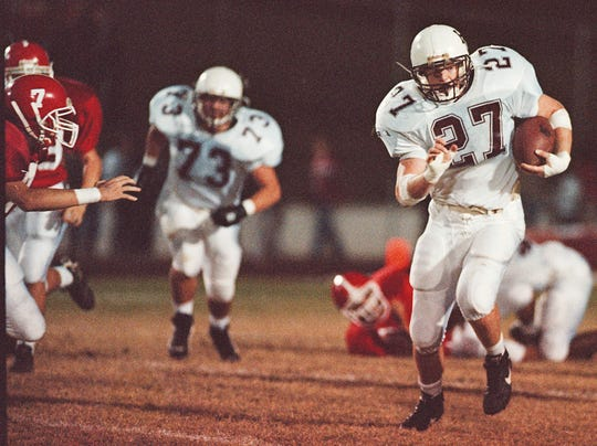 Eric Egan takes off for a big gain in Henderson County's game against Daviess County during the 1998 season.