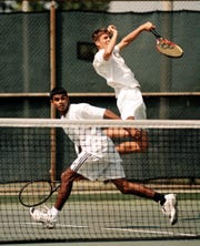 Henderson County's Wimal Wijenayake, left, and Will Graham show their winning form during a doubles match against Ballard's Will Parsons and Mike Davis during the 1999 KHSAA State Tennis Championships in Lexington.