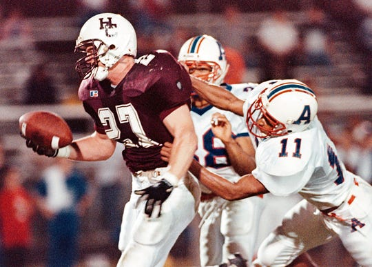 Eric Egan carries the ball against Apollo during the 1998 season. Egan is one of the 2019 inductees into the Henderson County Sports Hall of Fame.