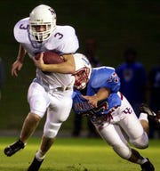 Tanner Siewert, a member of the 2019 class of the Henderson County Sports Hall of Fame, breaks a tackle during Henderson County's 2001 game against Union County.