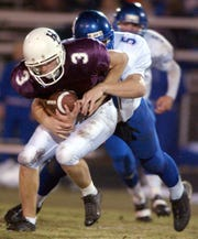 Tanner Siewert is tackled on a punt return during the 2003 game against Apollo.
