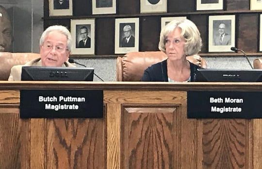 Magistrates Butch Puttman and Beth Moran are sitting members of the City County Cooperative Group. Both voted in favor of attaching a $3.25 911 fee to county water bills. (Aug. 13, 2019).