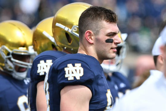 Notre Dame Fighting Irish tight end Cole Kmet (84) watches on the bench in the first quarter of the Blue-Gold Game at Notre Dame Stadium.