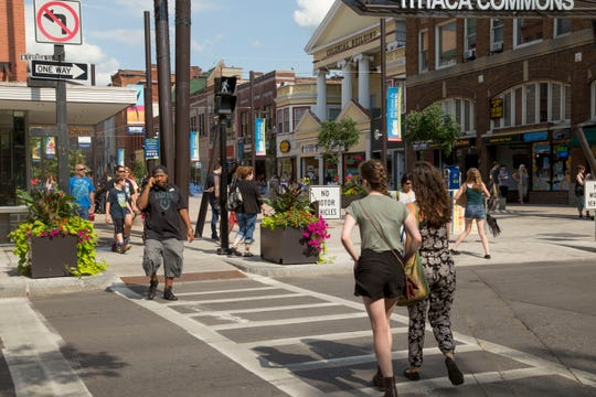 2016: Pedestrians cross the street by the Ithaca Commons.
