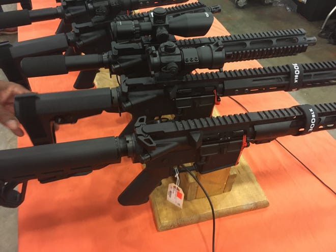 """Some of the items in high demand at a gun show in Jackson, Mississippi, on Aug. 10, 2019, are pistols that are equipped with several accessories — such as a high-capacity magazine — making them similar to short rifles, but without the same federal regulations. Guns purchased in Mississippi often end as """"crime guns"""" on the streets of Chicago."""