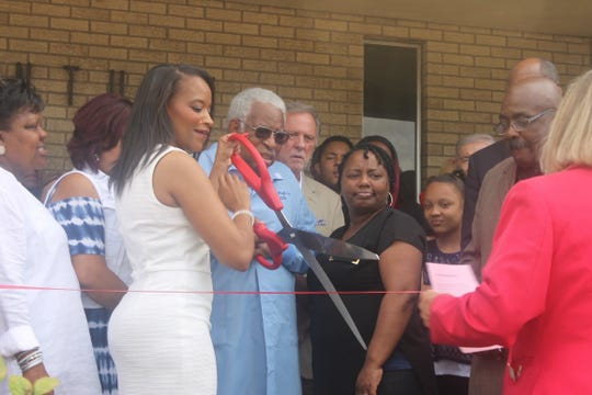 Sabrina Blue, chief executive officer, and Dr. Melvin Wright, the first and only dentist at Helping Hands until summer 2019, cut the ribbon when the dental clinic held a grand opening in June 2018.