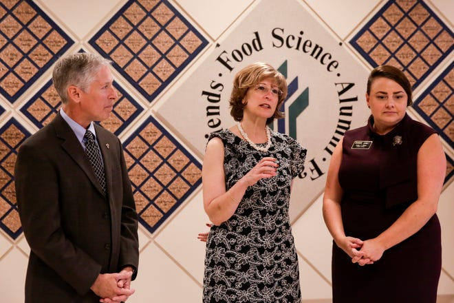 USAID deputy administrator Bonnie Glick, center, speaks with the media before a tour of the Philip E. Nelson Hall of Food Science labs, Tuesday, Aug. 13, 2019, at Purdue University in West Lafayette.