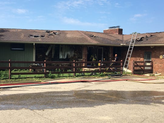 An Oceola Township home was damaged in a blaze, Tuesday, Aug. 13, 2019.