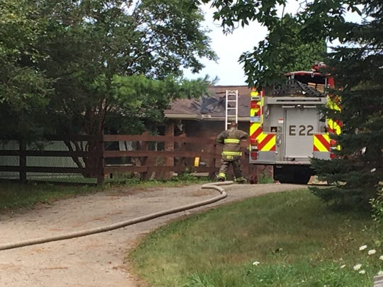 Firefighters battle a blaze that damaged a home on Eager Road in Oceola Township, Tuesday, Aug. 13, 2019.