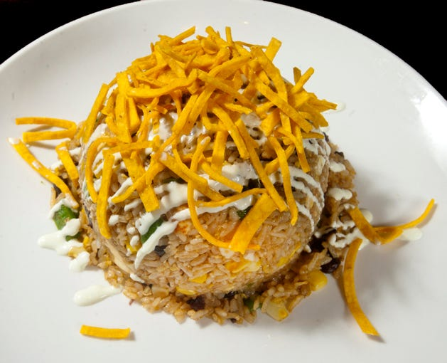 Dragon King's Daughter's Mexican fried rice is made with queso fresco, black beans, sweet corn, jalapeno and egg and is topped with wasabi sour cream and corn tortilla strips.08 August 2019