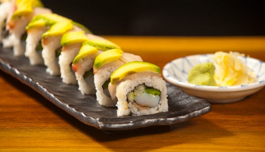 """Dragon King's Daughter's """"screaming baby sushi"""" is made with scalops, jalepeno and cucumber in a hot sauce, wrapped in sushi rice then topped with avocado and hamachi (a Japanese yellow tail amberjack.)08 August 2019"""