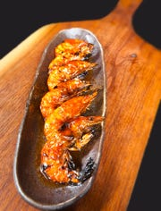 The Dragon King's Daughter's soft-shelled shrimp are barbecued on a robata grill with soy butter. The shrimp are then eaten shell and all. Aug. 8, 2019