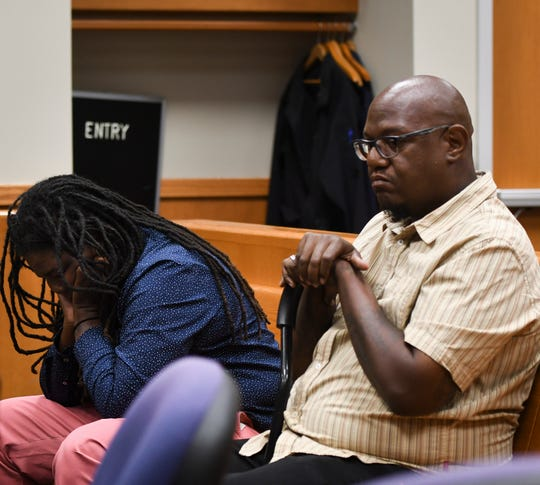 Former MSU basketball player Donita Johnson, left, and Corey Riley  appear in 54B District Court in East Lansing, Michigan, Tuesday, Aug. 13, 2019, for their preliminary hearings.  They are accused of defrauding the university's healing fund for survivors of abuse from former sports medicine doctor Larry Nassar.