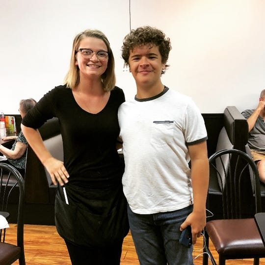 """Gaten Matarazzo, who portrays Dustin on Netflix's """"Stranger Things,"""" posing for a photo with Stateside Deli & Restaurant employee Grace Phillips on Monday, Aug. 12, 2019. The actor stopped to eat at the Okemos restaurant."""