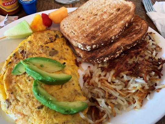 An omelet, hash browns and wheat toast from Doreen's Cup of Joe, Marco Island.