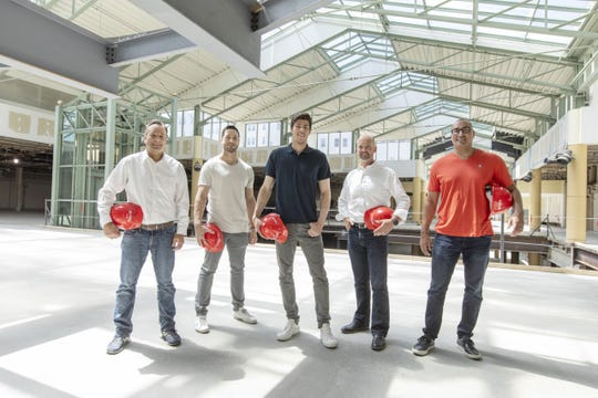 Ryan Braun and Christian Yelich, second and third from the left, are new investors in The Avenue. That project is led by Josh Krsnak, from left, Tony Janowiec and Omar Shaikh.