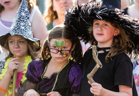 "Youngsters line up to participate in the costume contest during ""The Wizard of Oz"" 75th anniversary event on Thursday, Aug. 7, 2014, in downtown Oconomowoc."