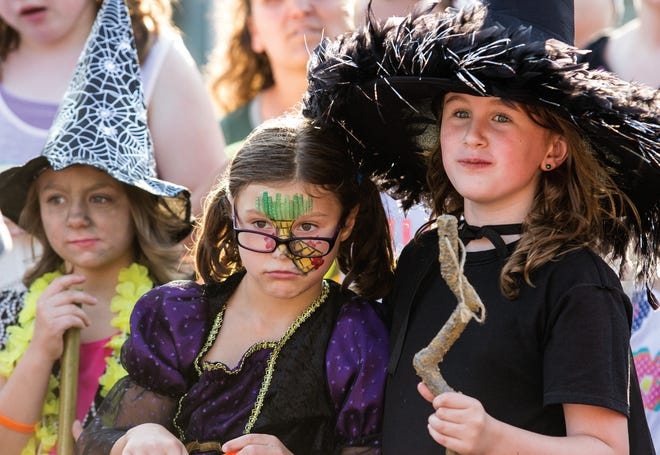 """Youngsters line up to participate in the costume contest during """"The Wizard of Oz"""" 75th anniversary event on Thursday, Aug. 7, 2014, in downtown Oconomowoc."""