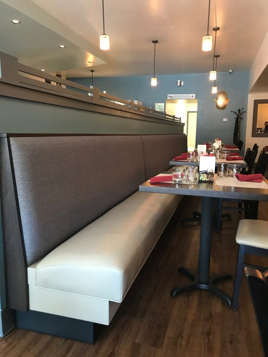 Orenda has a modern look and sophisticated color palette. In addition to banquette seating, there are freestanding tables, counter seats at the windows and seats at the bar.
