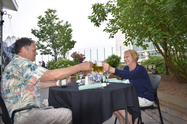 Tom Schroeder and his wife, Margie, toast with nonalcoholic beer during a date night staged as a surprise by the staff at Aurora St. Luke's Medical Center several days before Tom received a heart transplant last August. He was at St. Luke's for 50 days while awaiting a new heart and he craved non-hospital food.
