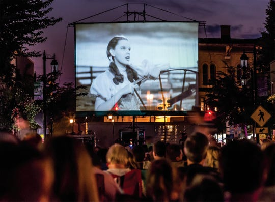 "Dorothy lights up the 40-foot screen in downtown Oconomowoc during the 75th anniversary screening of ""The Wizard of Oz"" on Thursday, Aug. 7, 2014. Thousands of fans were on hand to view the movie which was said to have premiered on Aug. 12, 1939, at the Strand Theater in Oconomowoc."