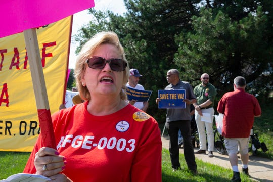 """Debra Graff of West Allis shouts """"What's disgusting? Union busting!"""" with fellow pickets on the corner of South 47th Street and West National Avenue at the VA Medical Center Tuesday."""