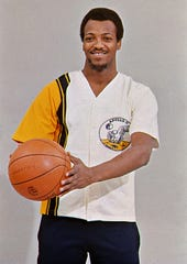 Former Marquette University star Ric Cobb shows off a warm-up jersey with the Apollo 11 patch.