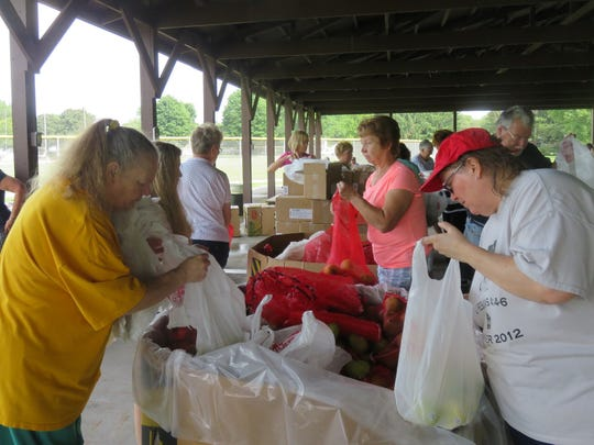 Every third Friday of the month since July 2014, Feeding America Eastern Wisconsin has delivered food to Oconomowoc, and more than 50 volunteers from Our Savior's, St. Paul's Lutheran Church and the community unload and distribute it.